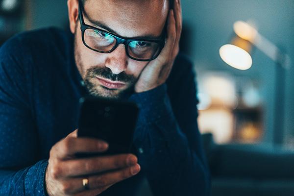 Man scrolling through smartphone