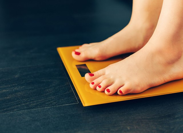 woman on scale weight loss
