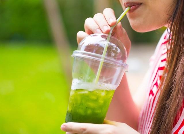 Woman drinking iced green tea