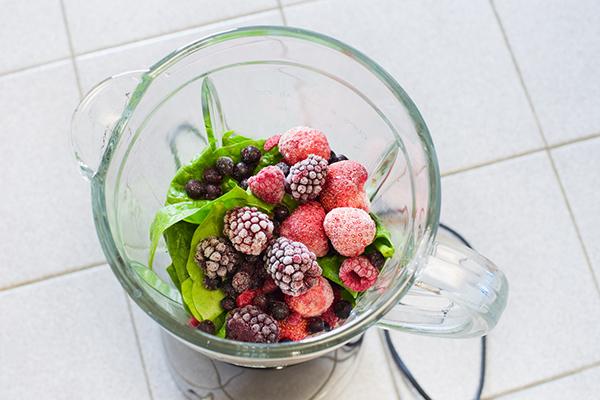 Frozen fruit in a blender
