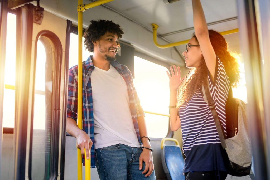 girl and boy looking sweet in the bus