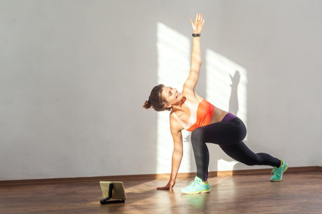 woman performing a lunge with a spinal twist