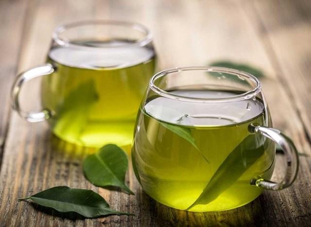 Green tea in mugs