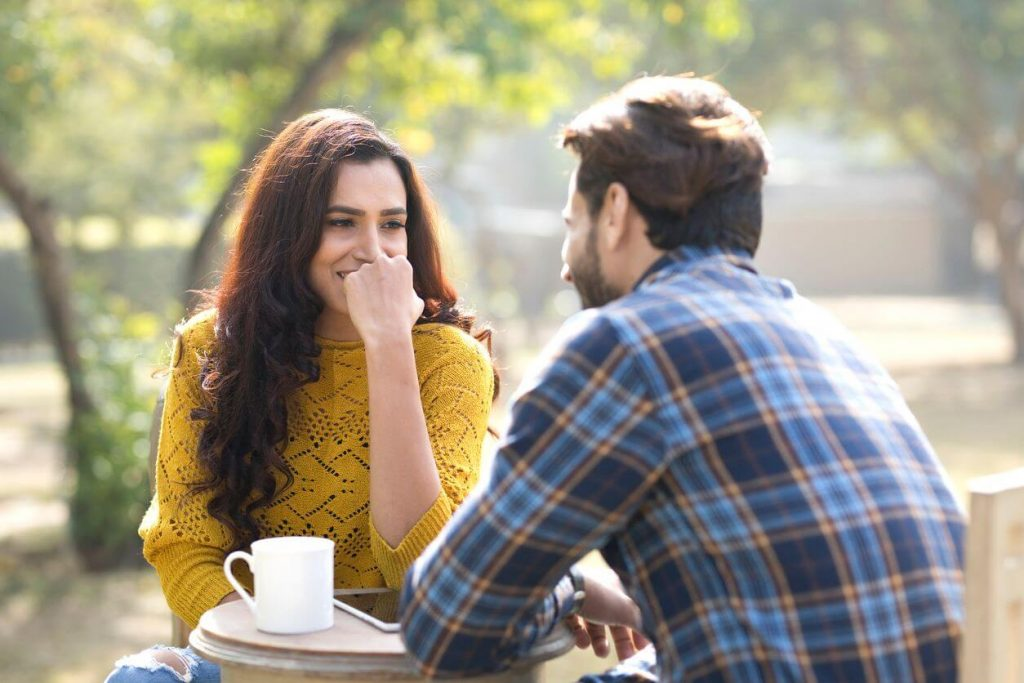 man and woman in a coffee date