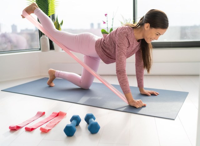 woman doing resistance band workout at home