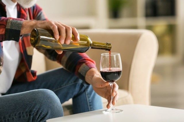 man pouring a glass of wine