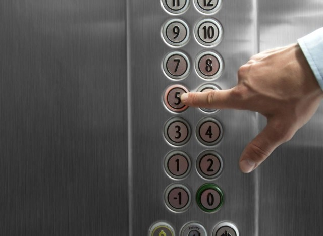 pressing elevator buttons