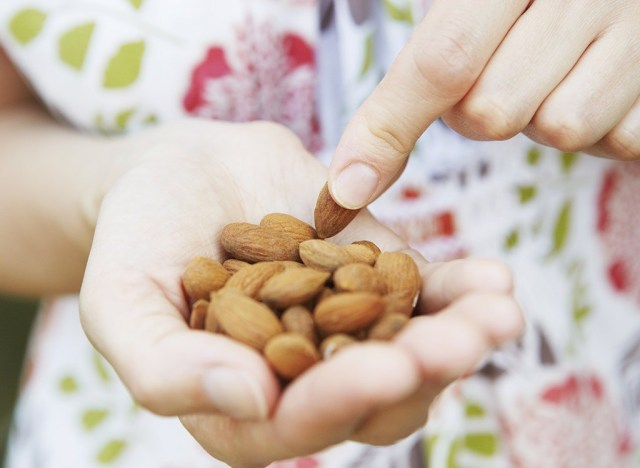 high protein almond snack in hand