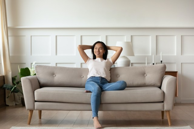 Happy woman sitting on a couch