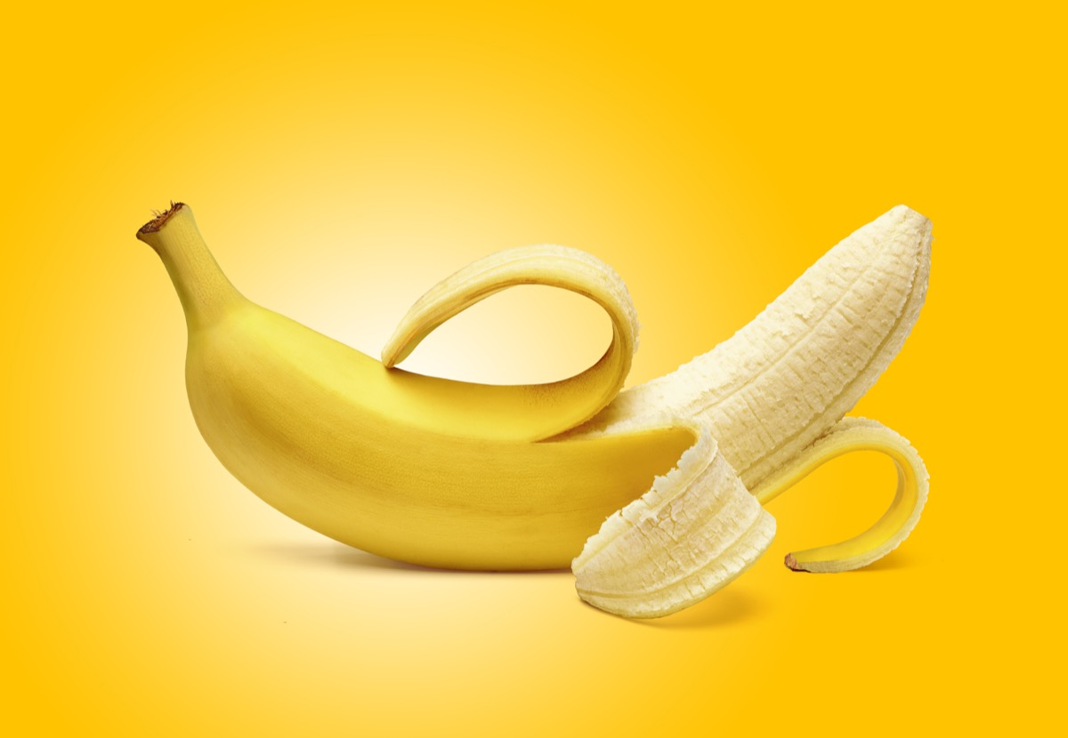 peeled banana against a yellow background