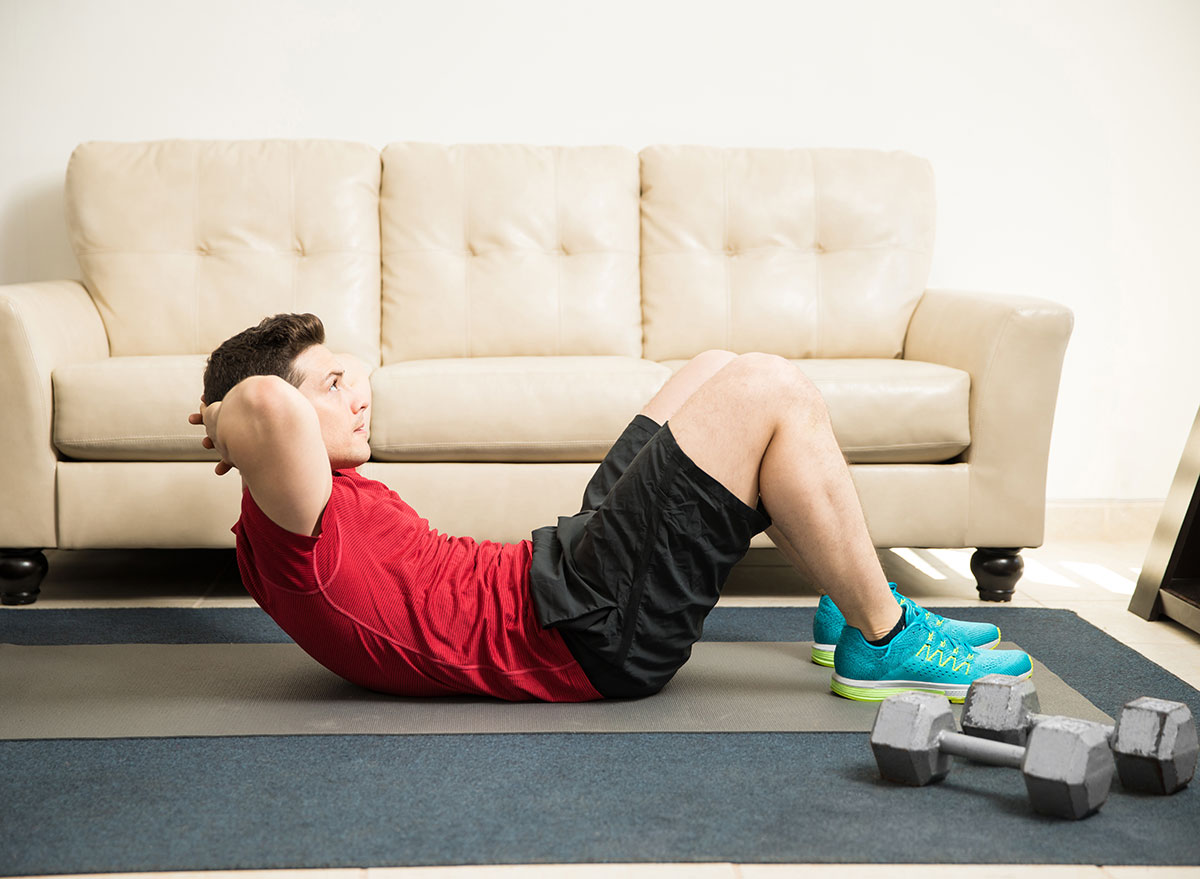 man excercise crunches