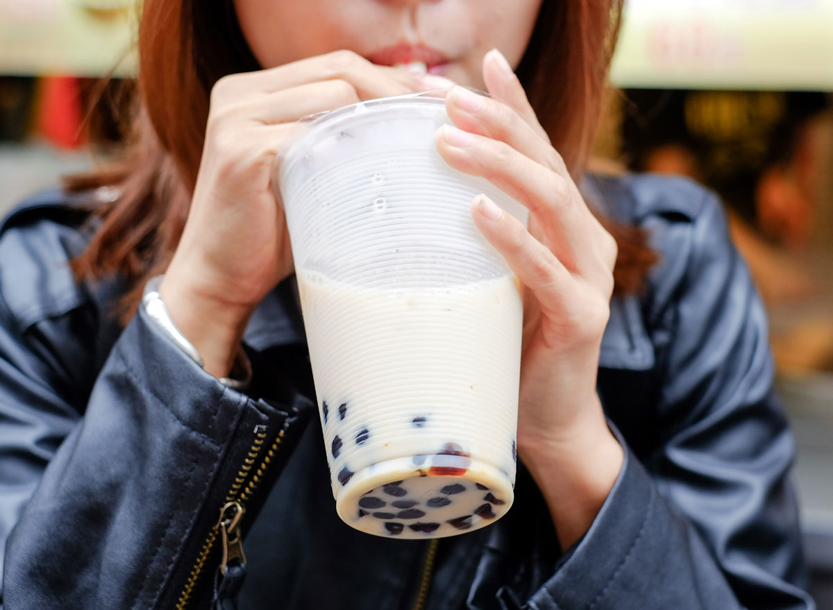 Woman sipping bubble tea