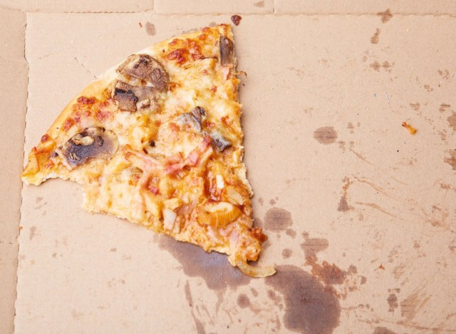 Slice of pizza with grease