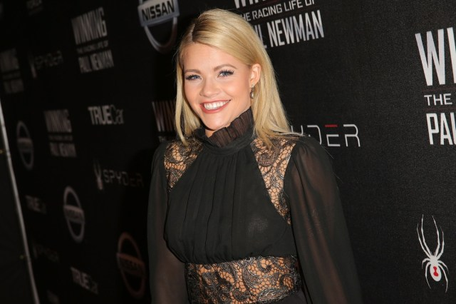 witney carson smiling in black lace dress on red carpet
