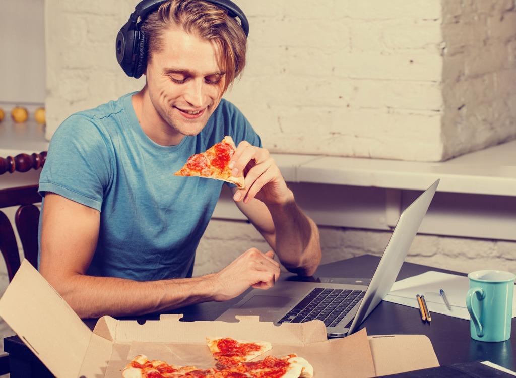 Eating pizza listing to music