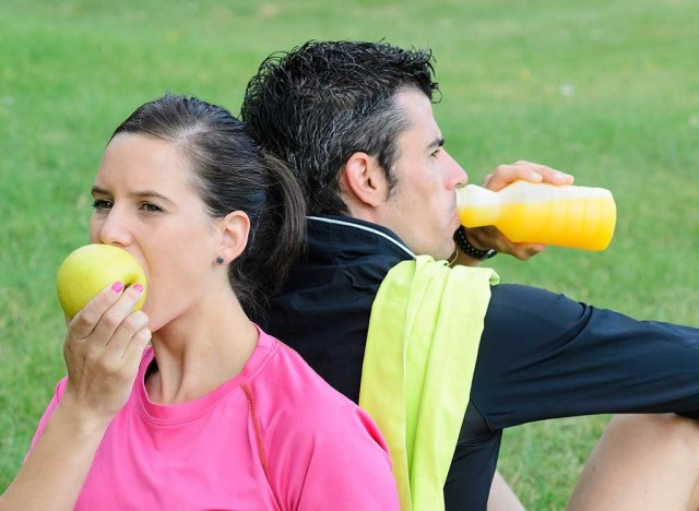 sporty couple eating
