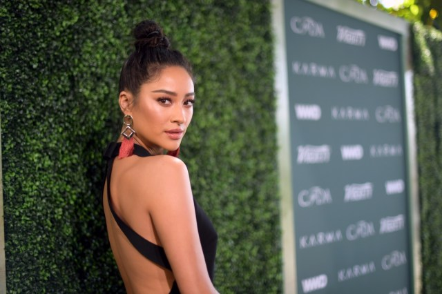 shay mitchell in black dress with pink earrings