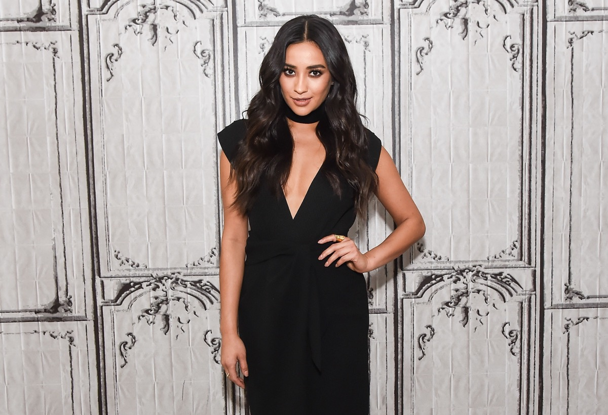 shay mitchell in black jumpsuit on red carpet