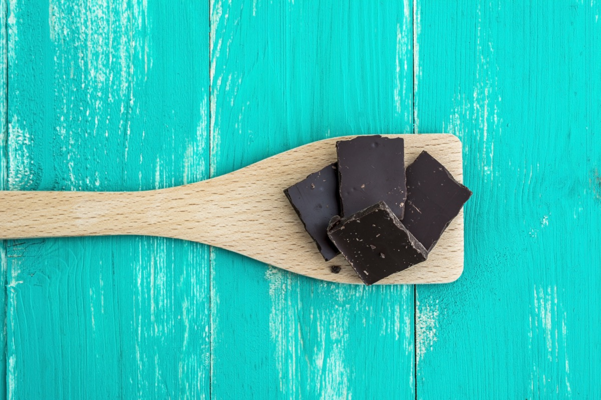 Dark chocolate on a turquoise colored table