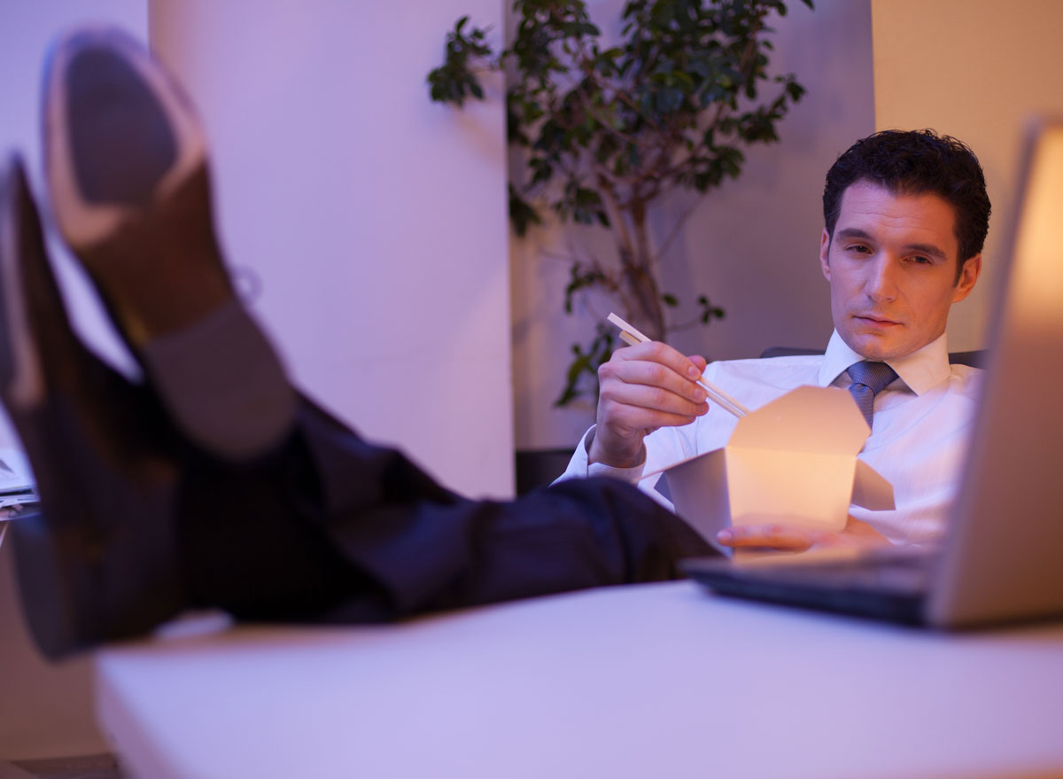 man eating late night at office