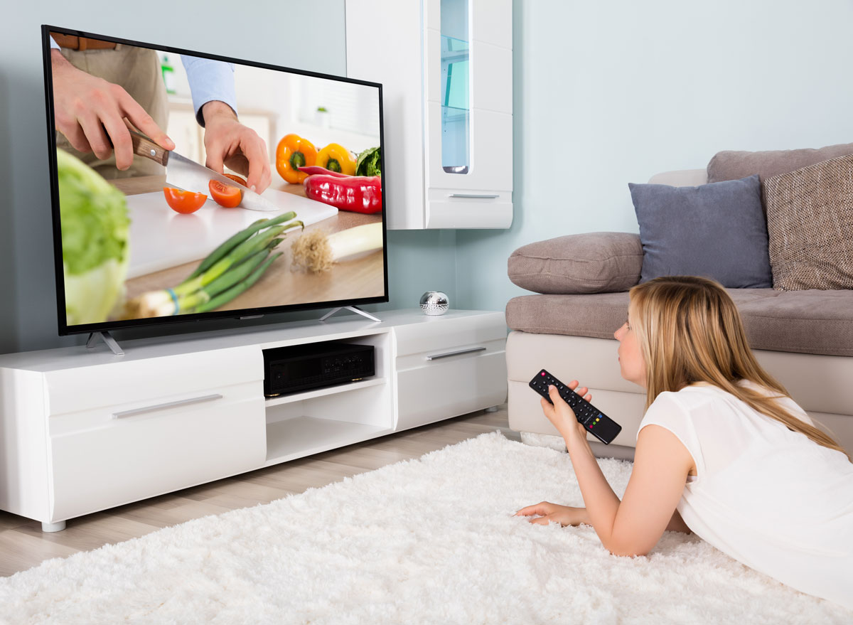 woman watching food show on tv