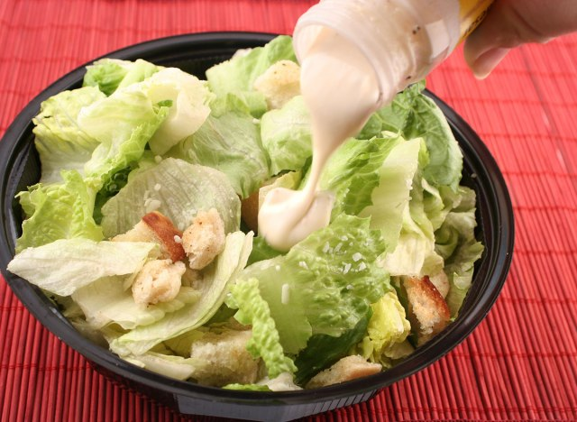 salad in bowl with dressing poured over top