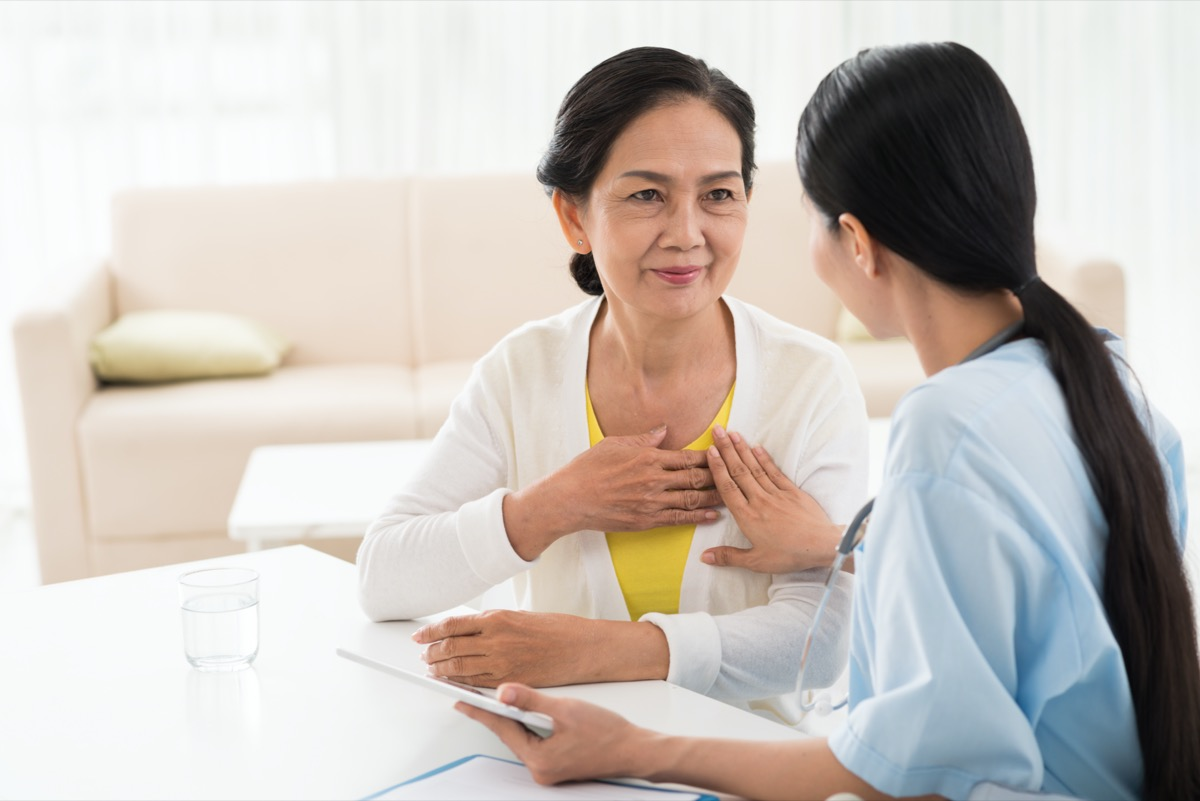 General practitioner and her aged patient talking about heart diseases