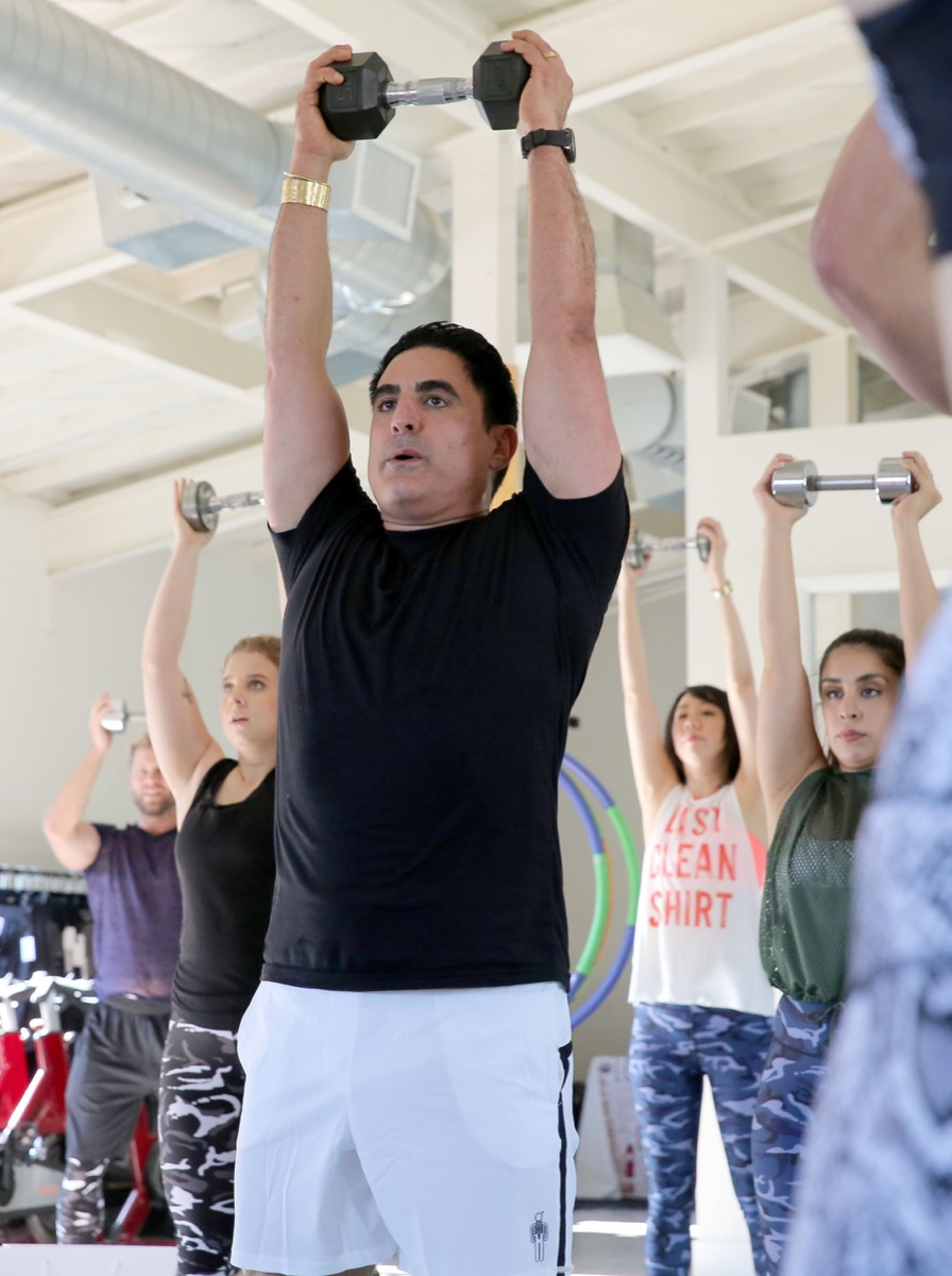 reza farahan exercising with free weights