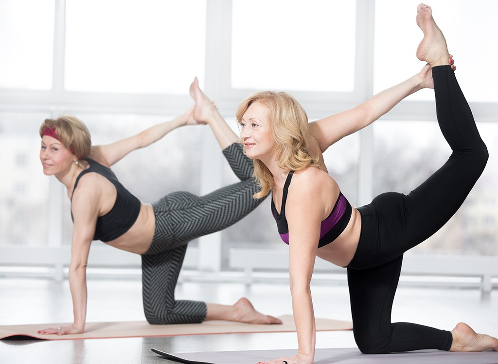 women doing yoga weight loss over 40