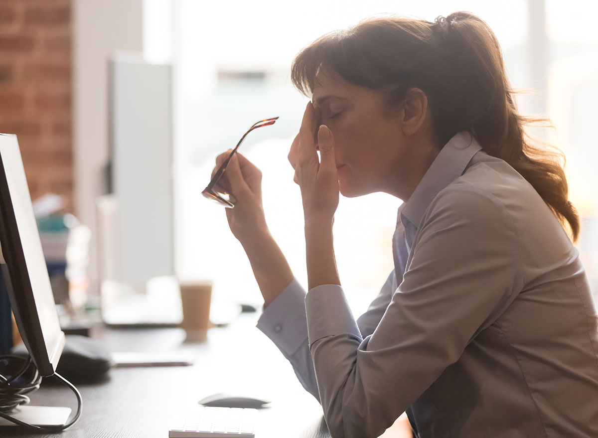 tired female worker sitting at a desk