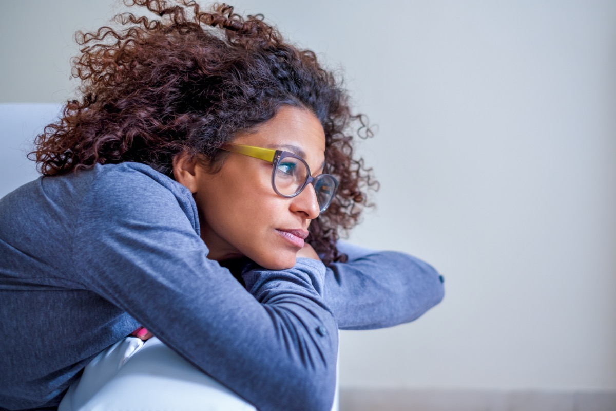 Woman pondering weight loss over 40